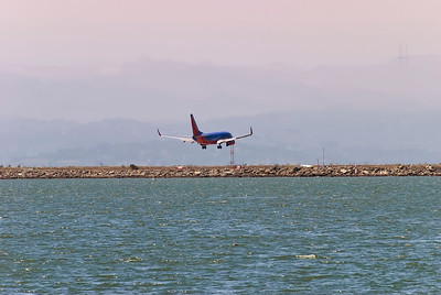 Southwest airliner landing at Oakland airport.  Taken from alameda monarch bay.